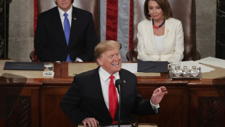WASHINGTON, DC - FEBRUARY 05:  President Donald Trump, with Speaker Nancy Pelosi and Vice President Mike Pence looking on, delivers the State of the Union address in the chamber of the U.S. House of Representatives at the U.S. Capitol Building on February 5, 2019 in Washington, DC. President Trump's second State of the Union address was postponed one week due to the partial government shutdown.  (Photo by Chip Somodevilla/Getty Images)