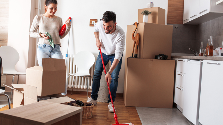 Young couple cleaning and setting new home.Moving house.