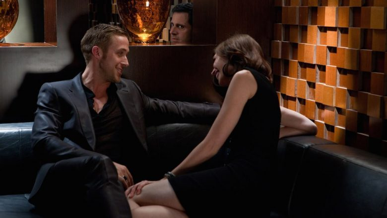 "RYAN GOSLING (left) as Jacob and STEVE CARELL (center) as Cal in Warner Bros. Pictures' comedy ""CRAZY, STUPID, LOVE."" a Warner Bros. Pictures release."