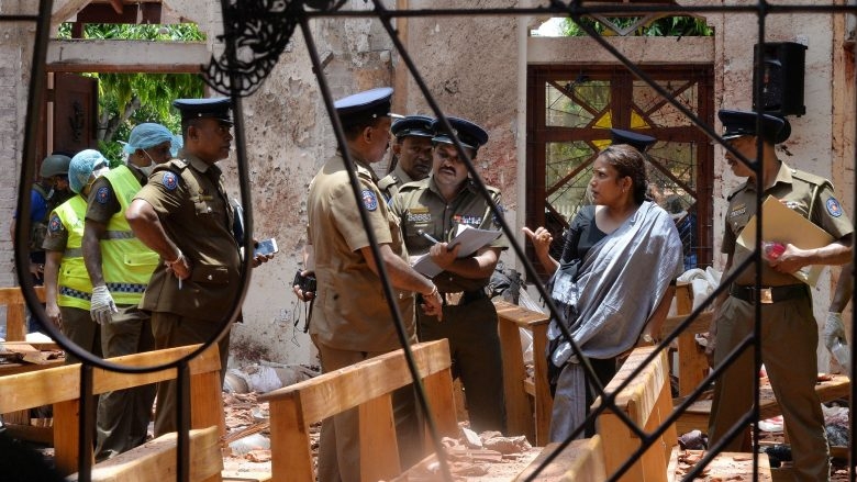 Crime scene officials inspect the site of a bomb blast inside a church in Negombo, Sri Lanka April 21, 2019. REUTERS/Stringer NO ARCHIVES. NO RESALES.