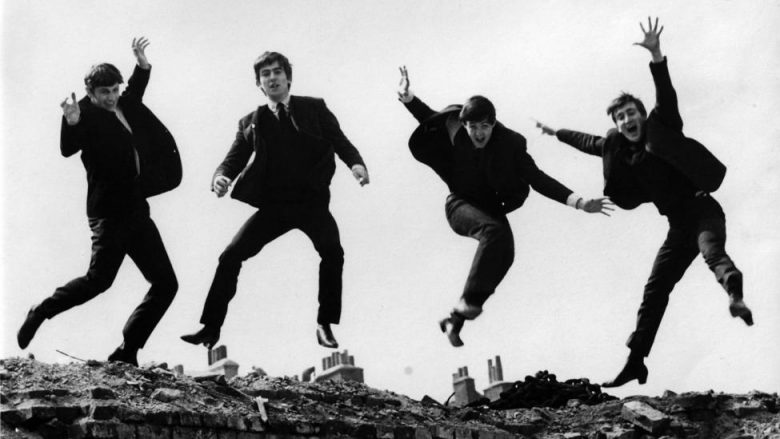 UNITED KINGDOM - APRIL 01:  Photo of BEATLES; L-R: Ringo Starr, George Harrison, Paul McCartney, John Lennon - posed, group shot - jumping on wall, Used on the Twist & Shout EP cover  (Photo by Fiona Adams/Redferns)
