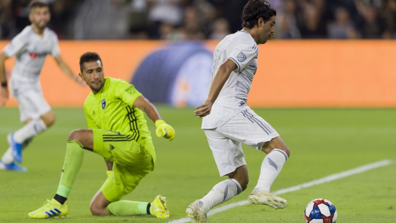 Aug 21, 2019; Los Angeles, CA, USA; Los Angeles FC forward Carlos Vela (10) moves past San Jose Earthquakes goalkeeper Daniel Vega (17) for a goal during the first half at Banc of California Stadium. Mandatory Credit: Kelvin Kuo-USA TODAY Sports