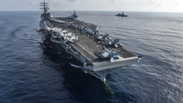 180831-N-PJ626-0010  SOUTH CHINA SEA (Aug. 31, 2018) The aircraft carrier USS Ronald Reagan (CVN 76) and the guided-missile destroyer USS Milius (DDG 69), center, conduct a photo exercise with Japan Maritime Self-Defense Force ships. The Ronald Reagan Carrier Strike Group is forward-deployed to the U.S. 7th Fleet area of operations in support of security and stability in the Indo-Pacific region. (U.S. Navy photo by Mass Communication Specialist 2nd Class Kaila V. Peters/Released)