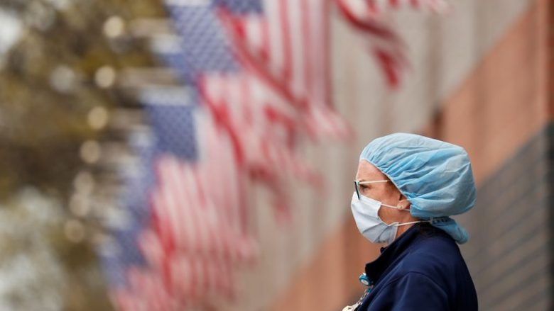 FILE PHOTO: A nurse wearing personal protective equipment watches an ambulance driving away outside of Elmhurst Hospital during the ongoing outbreak of the coronavirus disease (COVID-19) in the Queens borough of New York, U.S., April 20, 2020. REUTERS/Lucas Jackson/File Photo