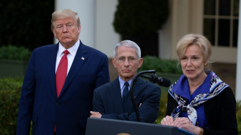 WASHINGTON, DC - MARCH 29: U.S. President Donald Trump and Anthony Fauci, Director of the National Institute of Allergy and Infectious Diseases, listen to White House coronavirus response coordinator Deborah Birx speak in the Rose Garden for the daily coronavirus briefing at the White House on March 29, 2020 in Washington, DC. The United States is advising residents of New York, New Jersey and Connecticut not to travel domestically after the number of reported coronavirus deaths doubled to over 2,000 nationwide within two days. (Photo by Tasos Katopodis/Getty Images)