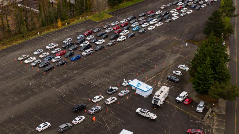 TACOMA, WA - NOVEMBER 28: In this aerial view from a drone, cars line up during a COVID-19 testing and flu shot event at the Tacoma Dome on November 28, 2020 in Tacoma, Washington. The free event, organized by Pierce County, comes as cases continue to rise in the area following the Thanksgiving holiday. (Photo by David Ryder/Getty Images)