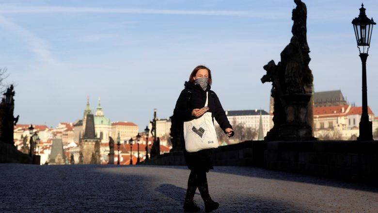 A woman walks across an empty medieval Charles Bridge in Prague, as the Czech government restricts movement of people to slow the spread of the new coronavirus disease (COVID-19), Czech Republic, March 16, 2020.  REUTERS/David W Cerny
