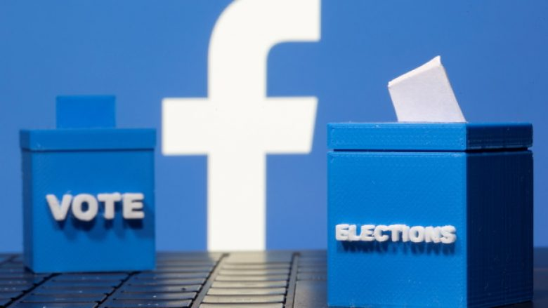 3D printed ballot boxes are seen in front of a displayed Facebook logo in this illustration taken November 4, 2020. REUTERS/Dado Ruvic/Illustration - RC2KWJ9Q1VN3